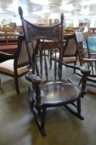 A 19th Century American carved oak rocking chair