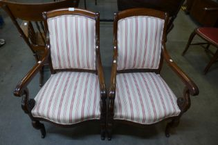 A pair of 19th Century French Empire style mahogany and upholstered fauteuils