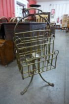 A Victorian Aesthetic Movement brass revolving newspaper stand