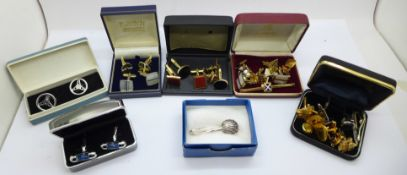 A collection of cufflinks, tie pins and a hallmarked silver napkin holder/clip