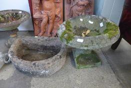 A concrete bird bath and a stone trough