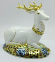 A Royal Crown Derby White Hart paperweight, 1180 of 2000, gold stopper, boxed and with certificate