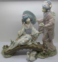 A Lladro figure group and stand, a/f, (swan figure restored) 30.5cm