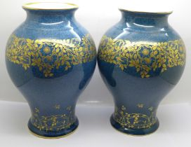 A pair of Royal Worcester vases, 23.5cm, one a/f