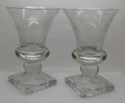 A pair of pressed glass vases with acid etched decoration, 22cm