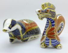 A Royal Crown Derby Dragon paperweight with silver stopper and a Moonlight Badger paperweight with