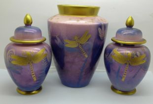 A Moorland Chelsea Works Burslem art pottery vase and matching pair of lidded vases decorated with