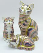 Three Royal Crown Derby Cat and Kitten paperweights, one gold and two silver stoppers