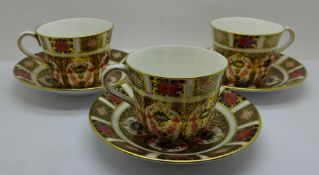 Three Royal Crown Derby 1128 pattern cups and saucers