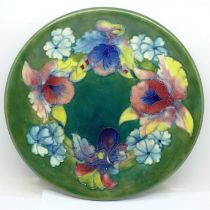 A Moorcroft Orchid pattern plate, signed on the base, 26cm