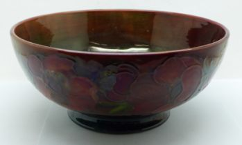 An early 20th Century Moorcroft bowl, anemone pattern with flambe glaze, signed on the base, 23.5cm,