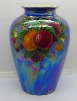 A Crown Devon lustre vase decorated with fruit, 20cm