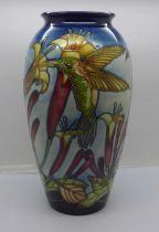 A limited edition Moorcroft vase decorated with hummingbirds, 60/75, designed by Paul Hilditch 2003,
