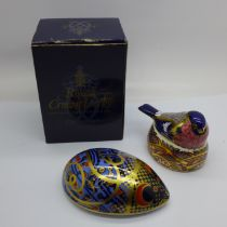 Two Royal Crown Derby paperweights, small chip to the tail of Bullfinch Nesting