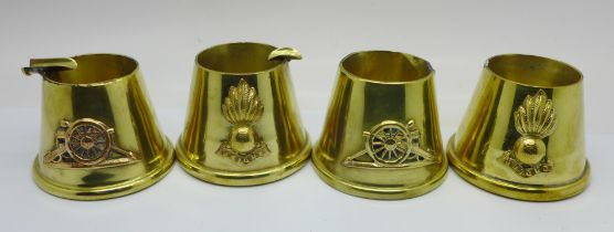Four trench art ashtrays, two a/f