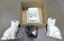 Two Staffordshire spaniels, a Carlton Ware butter dish, a pair of candlesticks, a Rubian Art Pottery