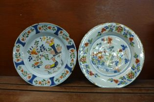 Two tin-glaze plates, a/f, 22cm
