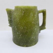 A soapstone jug, lacking lid