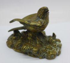 A bronze model of a bird, signed