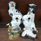A pair of Beswick Staffordshire Spaniels, a Royal Doulton Siamese cat, a Markay Art pottery duck, an