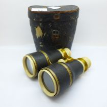 A pair of brass and ivory binoculars, cased