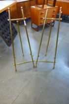 A pair of brass easels, 108cms h