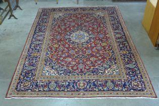 A Persian hand made blue ground rug, 345 x 240cms