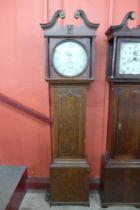 A 19th Century oak 30 hour longcase clock, the painted circular dial signed J. Wainwright,