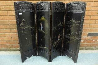 An early 20th Century Japanese carved ebonised and mother of pearl inlaid folding table screen