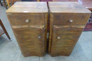 A pair of Art Deco figured walnut pot cupboards