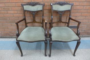 A pair of Edward VII mahogany and fabric upholstered elbow chairs