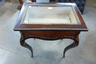 A French Louis XV style rosewood and gilt metal mounted bijouterie table