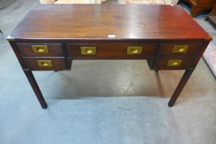 A mahogany and brass mounted campaign style desk