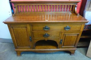 An Arts and Crafts Maple & Co. Ltd. oak sideboard