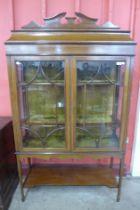 An Edward VII inlaid mahogany display cabinet