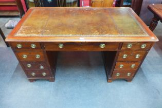 A Victorian oak pedestal library desk