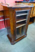 A Victorian inlaid walnut music cabinet