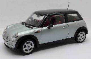 A Kyosho 1:18 scale Mini Cooper model vehicle