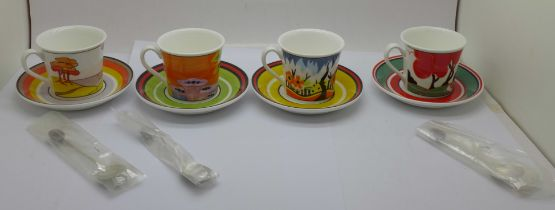 A set of four Wedgwood Clarice Cliff Cafe Noir coffee cups and saucers with spoons, one lacking a