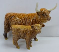 A Beswick Highland Cow and Calf