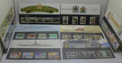 Twenty-four Royal Mail mint stamp packs