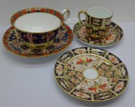 A Royal Crown Derby 1297 pattern cup and saucer, boxed and a Royal Crown Derby 2451 pattern trio