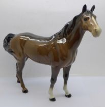 A Beswick brown hunter mare, looking to the right