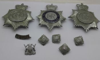 A collection of Nottingham and Nottinghamshire Police helmet and shoulder badges