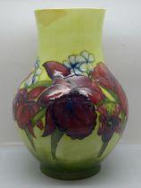 A Moorcroft orchid vase, chip to rim, 25.5cm