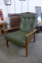 A teak and green vinyl armchair
