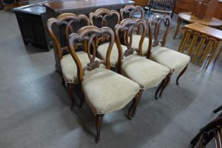 A set of six Victorian walnut balloon back dining chairs