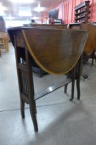 An Edward VII inlaid mahogany Sutherland table