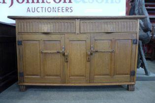 A Nigel Griffiths oak Cotswold style sideboard