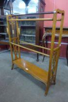 A Victorian oak towel rail
